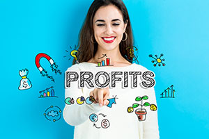 woman in front of blue background pointing at black profits text surrounded by profits related illustrations